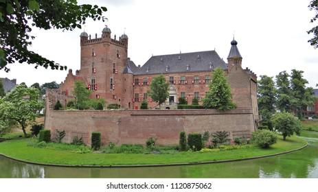 The old medieval castle 'Kasteel Huis Bergh' in 's-Heerenberg in the Netherlands with big towers and walls.
