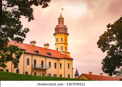 Old medieval castle in Nesvizh, Belarus, Europe. Landmark with sunset cloudy sky in background. Architecture and travel.