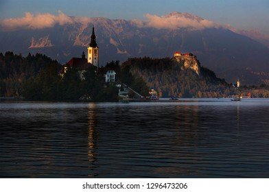 Old medieval castle on the rock against the mountains at sunset, Lake Bled, Slovenia