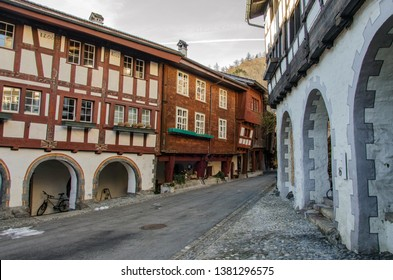 Old medieval city center Buchs of Werdenberg in a region St. Gallen in Switzerland with wooden and stone houses on a cloudy day in winter
