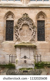 Old Medieval Drinking Fountain on Cathedral Wall in Europe