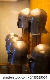 Old medieval metallic helmet of the Italian knight in the fortress (Castle) of Brescia, Lombardy, Italy. The element of armour to protect the head of the soldier (warrior). Black and white.