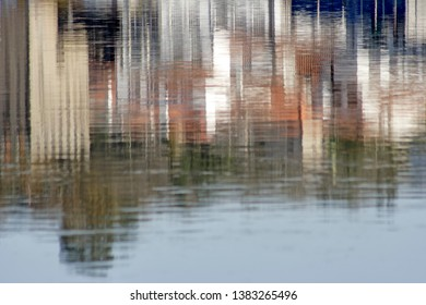 Old medieval Ponte de Lima city reflected on the Lima river border, north of Portugal