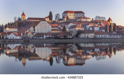 Old medieval town Ptuj with castle on the hill reflecting in river Drava, Slovenia