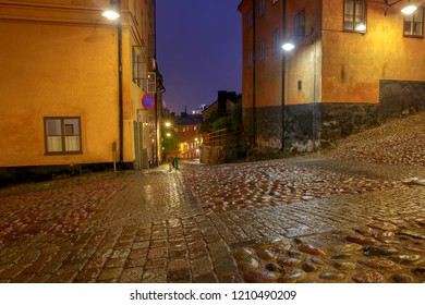 Old medieval traditional street in the night illumination. Stockholm. Sweden.
