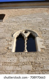 Old medieval window in the town of Montefalco, Umbria, Italy