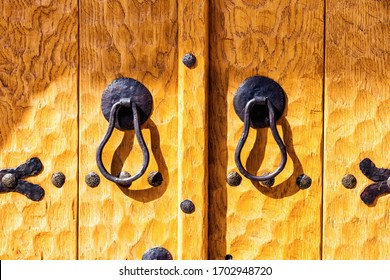Old medieval wooden door in a stone wall, detail