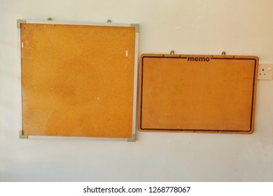 Old memo board stick on the wall for student used.