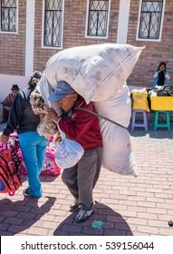 old men carrying wool at market Zumbagua, Ecuador Sept. 3rd 2016