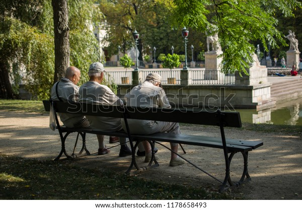 Cool Old Men Sitting On Wooden Bench Stock Photo Edit Now Ocoug Best Dining Table And Chair Ideas Images Ocougorg