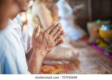 Old men are worshiping ritual beliefs.