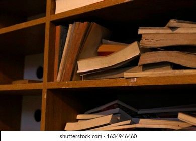 Old messy books on a shelf