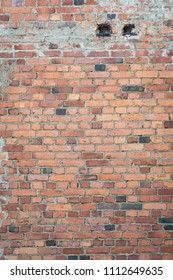 Old messy brick wall texture background exterior