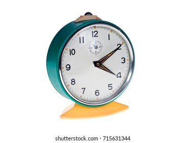 Old metal alarm clocks on a white background.