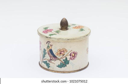 Old metal box with flower and bird pattern isolated