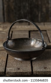 old metal brass sugar bowl for sugar refined sugar in the form of a flat basket with a handle. Elegant dishes can be used as candy bar or vase for dried fruits and nuts. Old kitchen utensils