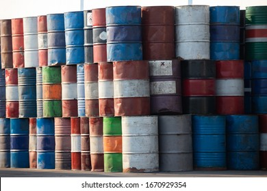 old metal chemical tanks in recycle factory. dirty oil steel drums background. metal chemical tanks in recycle factory. dirty oil steel drums background.