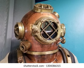 old metal diving suit with helmet and glass window
