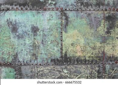 Old metal door on rivets