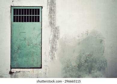 Old metal door on the wall. Vintage effect.