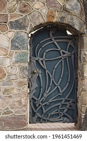 old metal door in stone wall. High quality photo - Shutterstock ID 1961451469