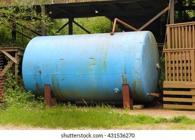 Old metal farmyard tank