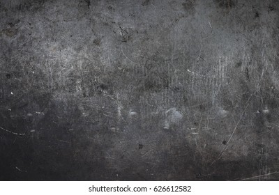 old metal floor with oil stains. over light and high contrast in background