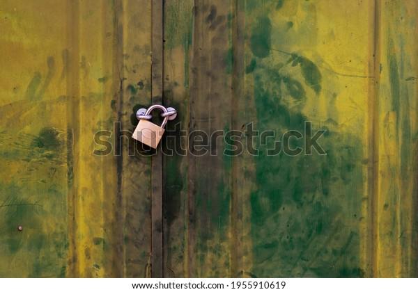 Old metal gate with padlock