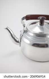 Old metal Kettle on a white background.