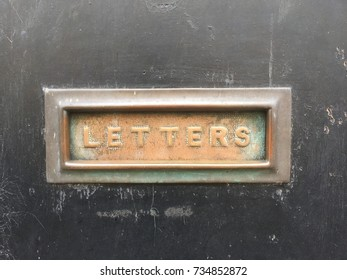 Old Metal Letter Box On a Black Door