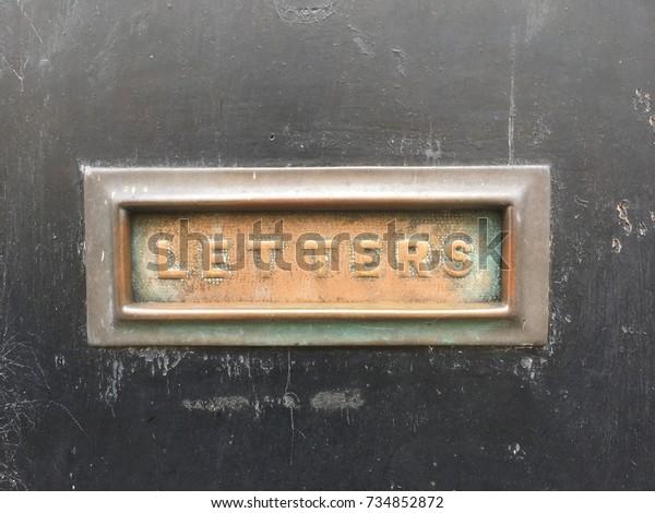 Old Metal Letter Box On a Black Door