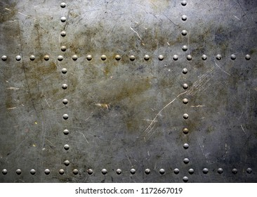 Old metal plate with rivets