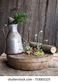 Old metal pot arranged with flowers