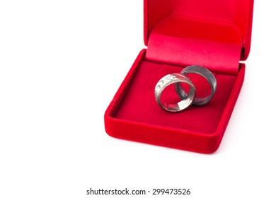 old metal ring jeweller red velvet box on white background