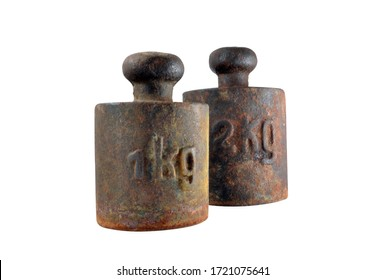 Old metal rusty 1 kg and 2 kg weights