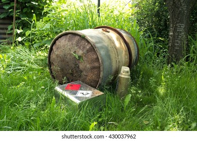 The old metal and rusty barrel for gasoline.  Ecological dangerous.