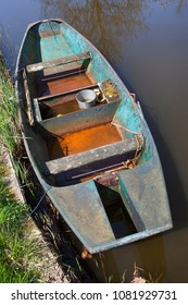 Old metal rusty rowing boat seen from above in the Netherlands