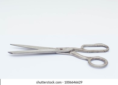 Old metal scissor isolated