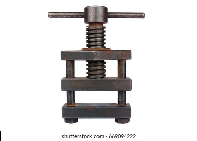 Old metal screw press isolated on white background