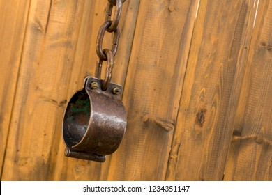 old metal shackles closed chain ring wooden wall background