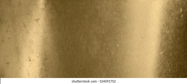 Old metal texture background with traces of use in gold