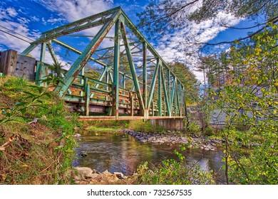 Old Metal Truss Bridge spanning the Sugar River in  Newport, New Hampshire.