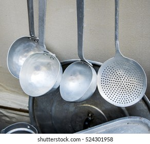 Old metal utensils for cooking on a local market.