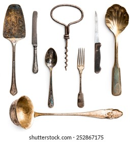 old metal utensils on a white background