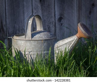 Old Metal Watering Can in Grass