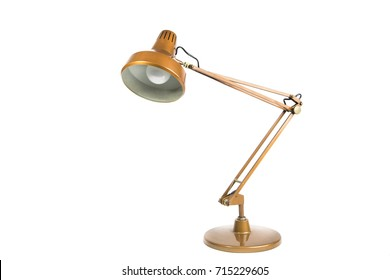 old metallic copper colored table lamp on white background / isolated portrait of a vintage table lamp