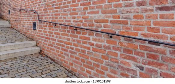 Old metallic handrail over wall