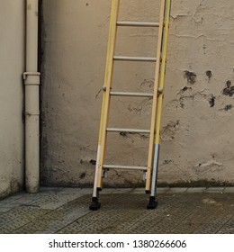 old metallic ladder on the wall in the street