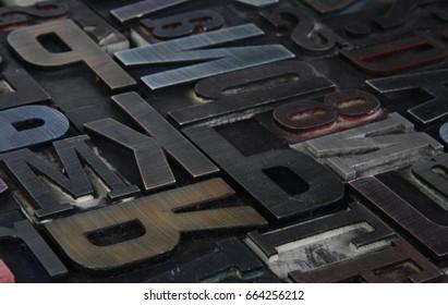 Old metallic letterpress printing blocks