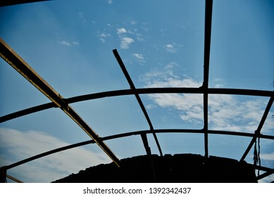 Old metallic structure with blue sky background unique photo